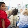 A teacher reads to children.