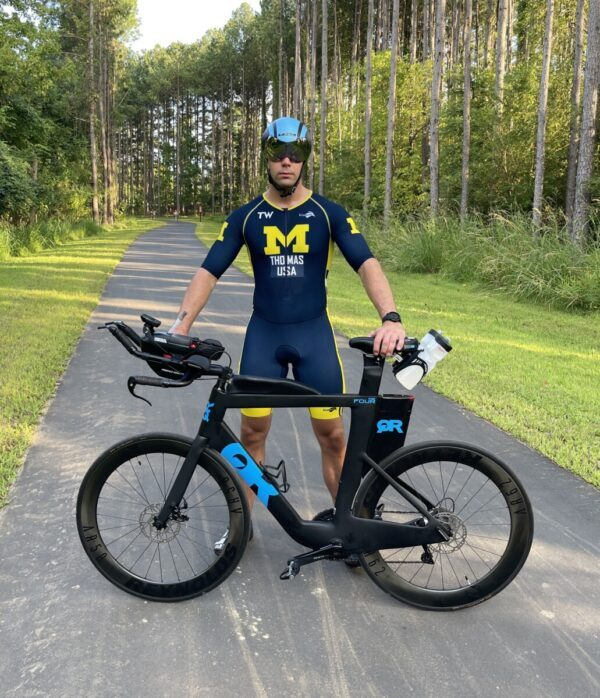 Tyler Thomas with his bike, racing for Aphasia Awareness
